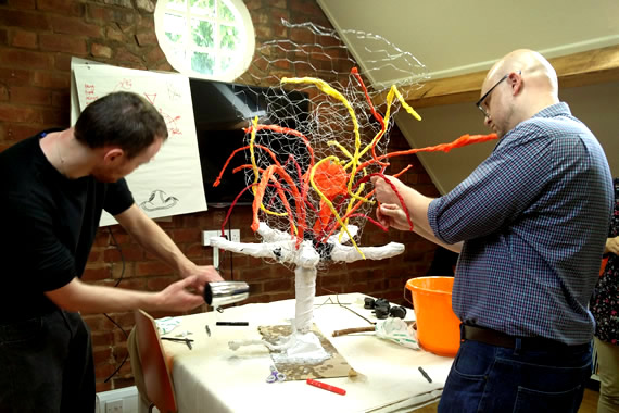 team sculpture vision garlands corporate mythe farm