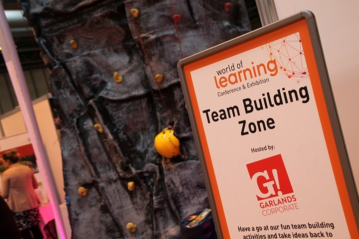 WOLCE exhibition garlands corporate climbing wall